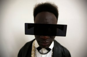 A visitor poses for a portrait during Lisbon Fashion Week